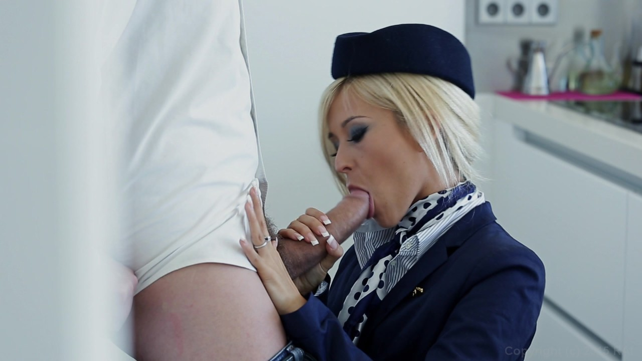 Sexy stewardesses give a lucky guy a hand job 3