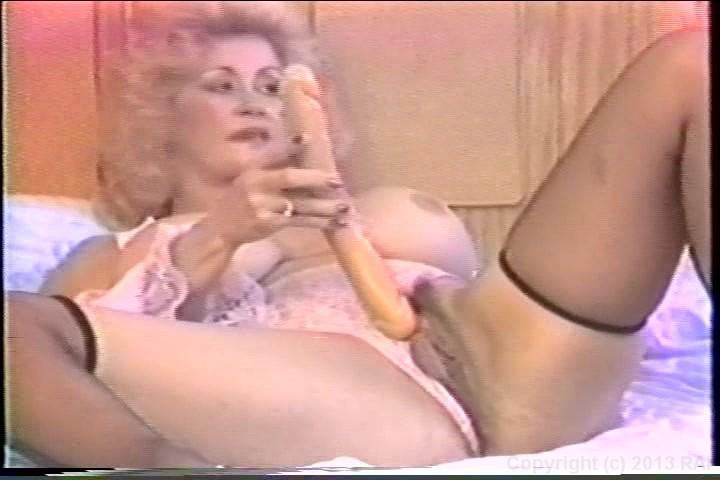 Woman orgasming while pegging